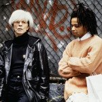 Nei panni di Andy Warhol, con Jeffrey Wright, in Basquiat, 1996